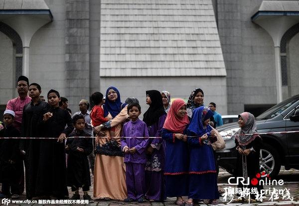 当地时间2015年9月24日,马来西亚莎阿南,穆斯林庆祝宰牲节。